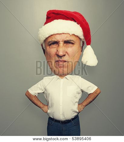 dissatisfied bighead man in santa hat over grey background