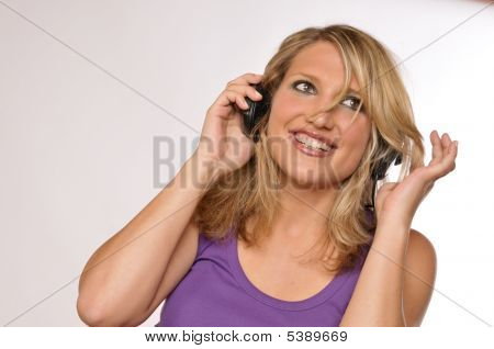 Happy Attractive Blond Woman With Headphones
