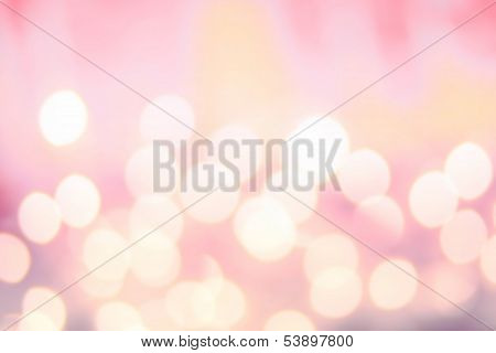 Defocused Bokeh Twinkling Lights Background. Colorful   Abstract Twinkled  Bright Golden Festive Bac