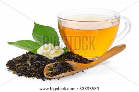 Cup with tea, flower of jasmine