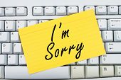 image of apologize  - Computer keyboard keys with index card with words I - JPG