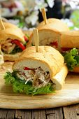 panini sandwich with chicken and vegetables on a wooden board