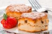 foto of devonshire  - Plate of scones with strawberry decoration and fork - JPG