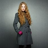 stock photo of overcoats  - Portrait of young woman in autumn coat - JPG