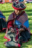 CUZCO, PERU - JULY 15: women weaving in the peruvian Andes at Cuzco Peru on july 15th, 2013. In the