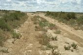 foto of groundwater  - Groundwater road in the desert steppe noon - JPG