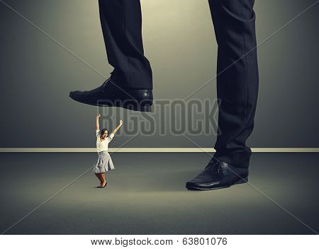 joyful woman under big mans legs over dark background