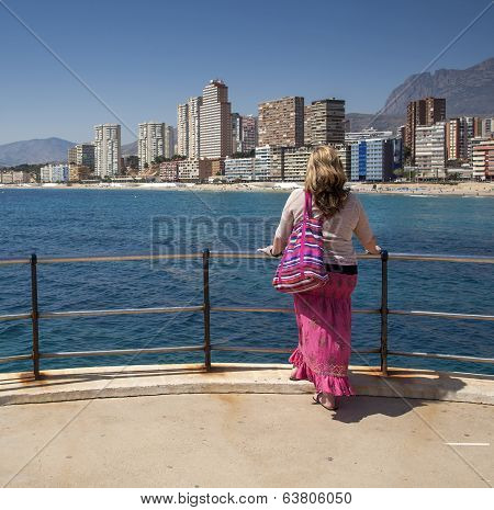 Beautiful Lady Gazes Over Benidorm, Spain.