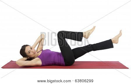 Young Woman Doing Crunch During Workout