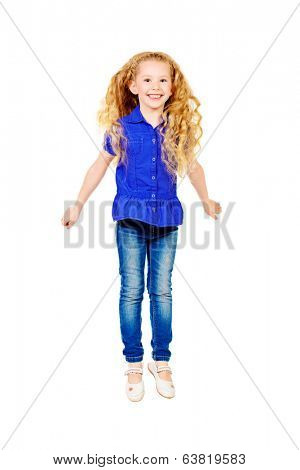 Pretty joyful girl with a beautiful long hair smiling at camera. Isolated over white.