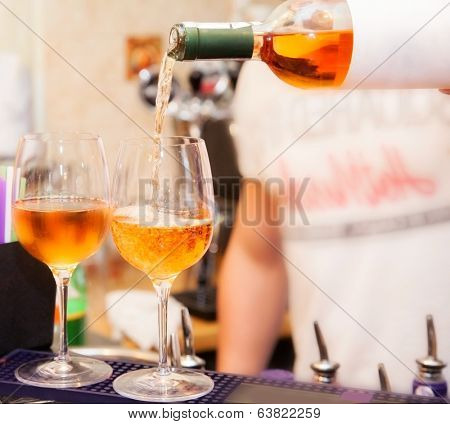 two glasses of wine on bar