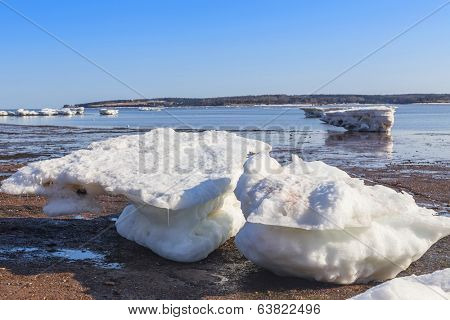 Spring break up of ice forms ice cakes on the shore of Charlottetown Harbor.
