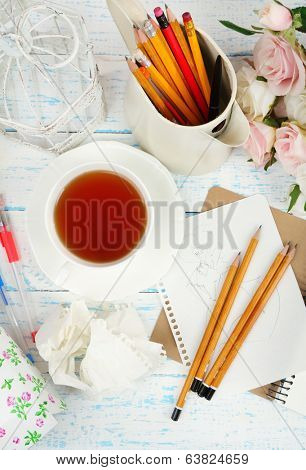 Composition with notebook and pencils on wooden table close-up