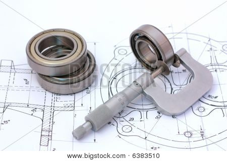 Micrometer Measuring Ball Bearing On Technical Drawing