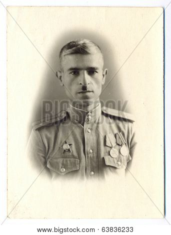 Portrait of a Soviet Army lieutenant who was awarded the Order of the Red Star and two medals