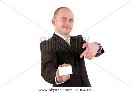 smiling young business man pointing at business card