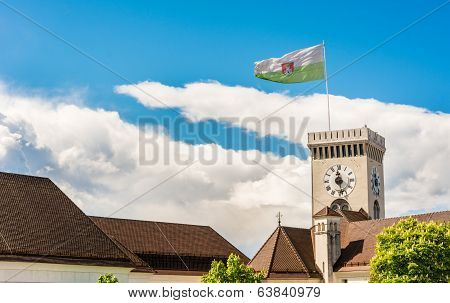Castle Clock Tower With A Flag