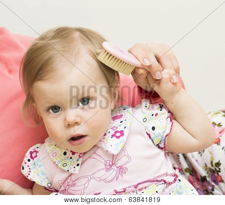 Mother Is Teaching The Daughter To Brush Hair.