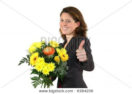 beautiful business woman with a bunch of flowers posing with the thumbs up sign