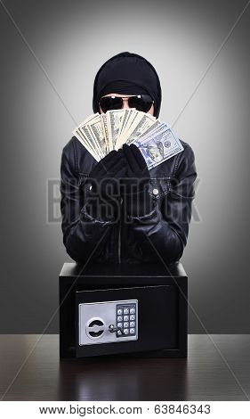 Thief Holding Dollars