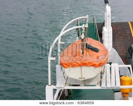 A Lifeboat Being Winched On Ferryboat