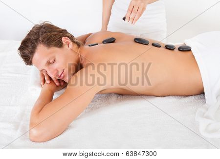 Man Getting Hot Stone Massage