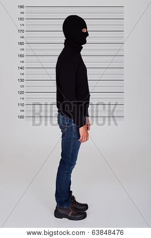Burglar Standing Against Police Lineup