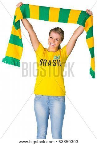 Happy football fan in brasil tshirt on white background