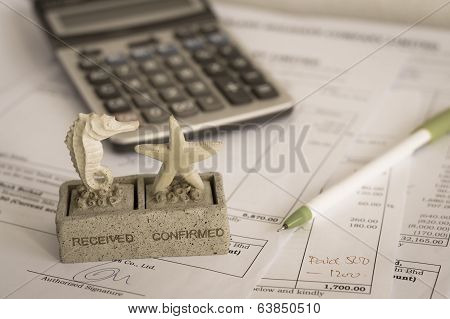 Office Document With Rubber Stamp, Pen And Calculator