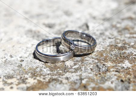 Wedding Rings On A Stone Wall