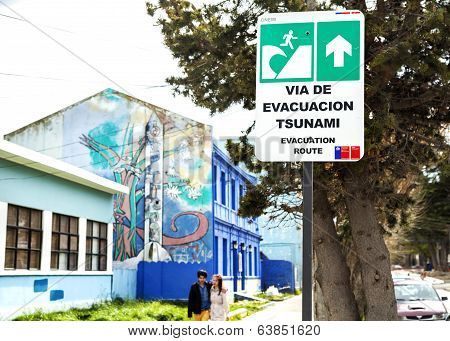 Street Sign Showing Evacuation Way In Case Of Tsunami