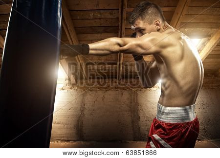Young man boxing exercise in the attic