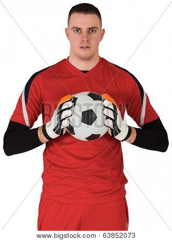 Goalkeeper in red looking at camera on white background