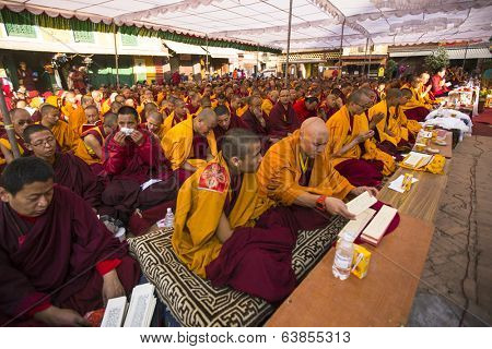 KHATMANDU, NEPAL - DEC 15, 2013: Unidentified tibetan Buddhist monks near stupa Boudhanath during festive Puja of H.H. Drubwang Padma Norbu Rinpoche's reincarnation's.