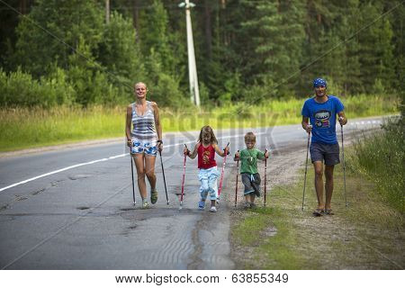 NIKOLSKY, RUSSIA - JULY 14, 2013: Participants (kids: Nikolay Dubinin /4, Darja Zhochkina /6) during of local competitions in Nordic walking devoted to the Day of Health.