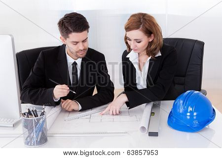 Portrait Of Two Sincere Architects Working