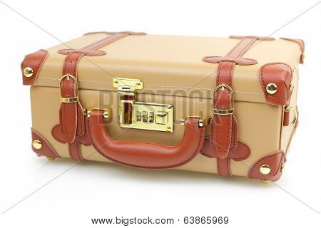 Closed brown suitcase isolated on white