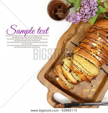 Sweet brioche bread on tray with chocolate spread