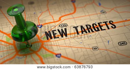 New Targets - Green Pushpin on a Map Background.