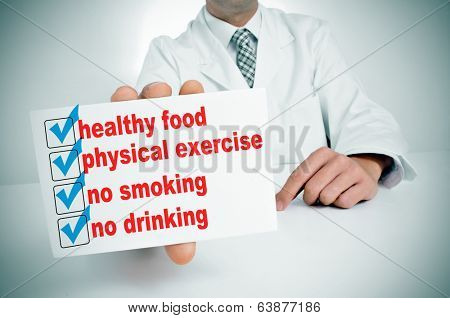 a man wearing a white coat sitting in a desk showing a signboard with some healthy habits, such as healthy food, physical exercise or no smoking