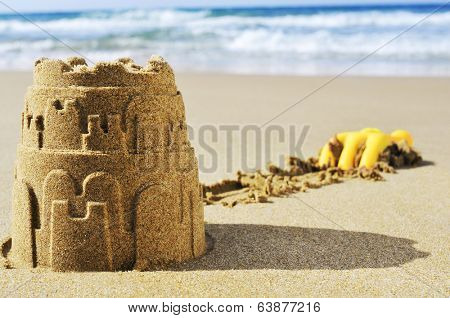 a sandcastle on the sand of a beach