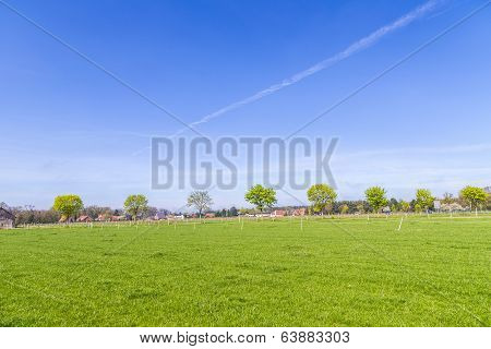 Rural Landscape  With Houses At The Horizon