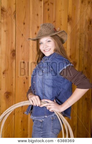 Woman With Hands On Rope Smiling