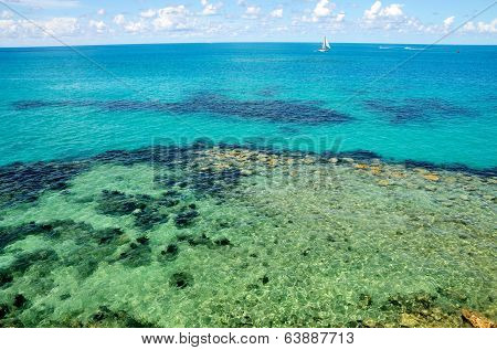 Clear Water, Blue Water, Sailing Boat And Blue Skies