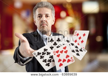 Bluff, Handsome man playing with poker cards