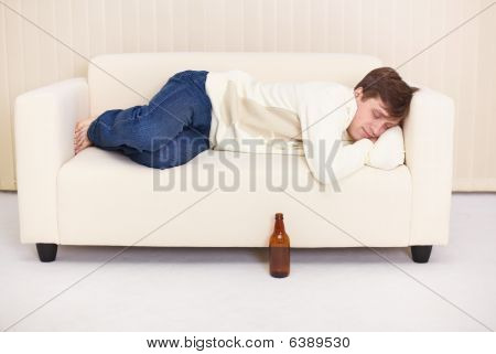 People Comfortable Sleeps On Sofa Having Got Drunk Beer