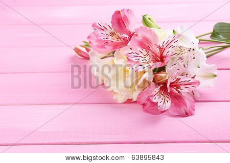 Beautiful spring flowers on wooden table