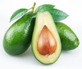 picture of avocado  - Avocado cut in half avocado with leaves on a white background - JPG