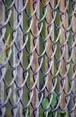 pic of chain link fence  - a rusting metal fence reinforced with a chain linked fence