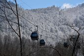 stock photo of ropeway  - Several glass-covered ropeway cabins in the mountains